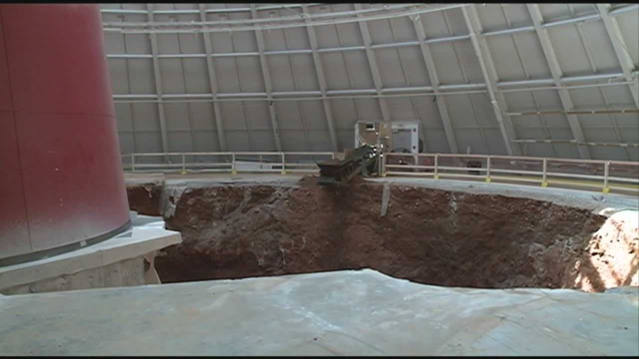 The National Corvette Museum is considering leaving the giant sinkhole that swallowed eight vehicles as a tourist attraction.