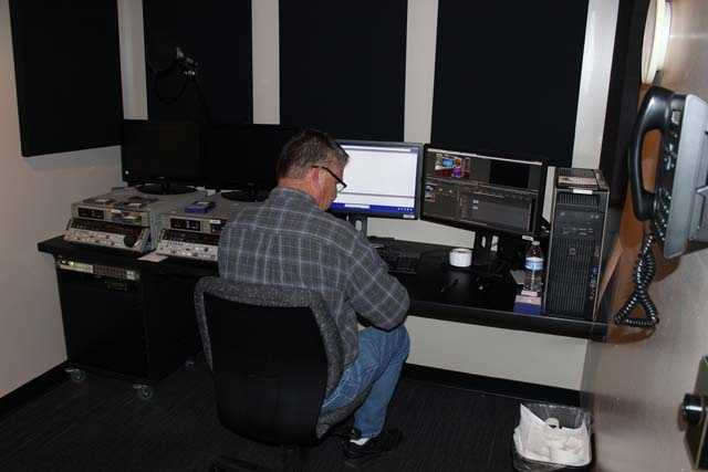 Editor Kevin Stanton prepares video for the morning newscast