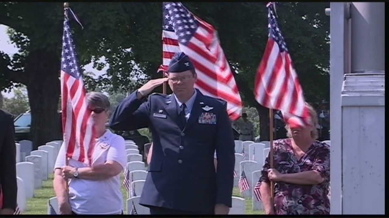 A memorial is held Monday at Cave Hill Cemetery in honor of Memorial Day.