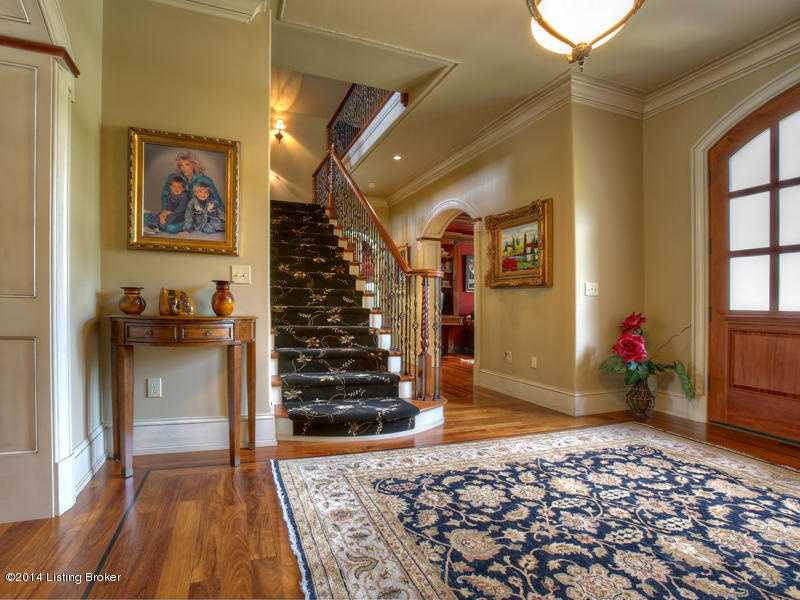 The foyer features beautiful wooden floors.