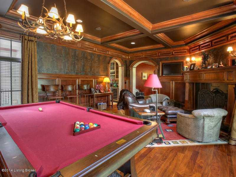 Sophisticated parlor boasts a pool table.