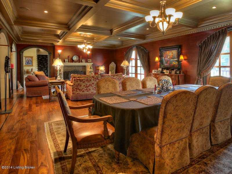 The golden ceiling adds a lavish touch to the formal living room and dining room.