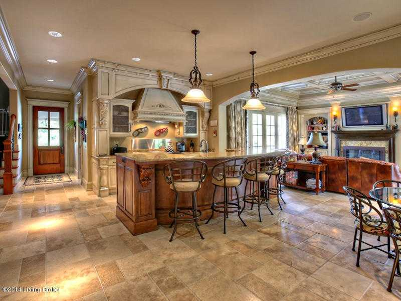 Beautiful open kitchen features bar seating, marble floors and the best modern appliances.