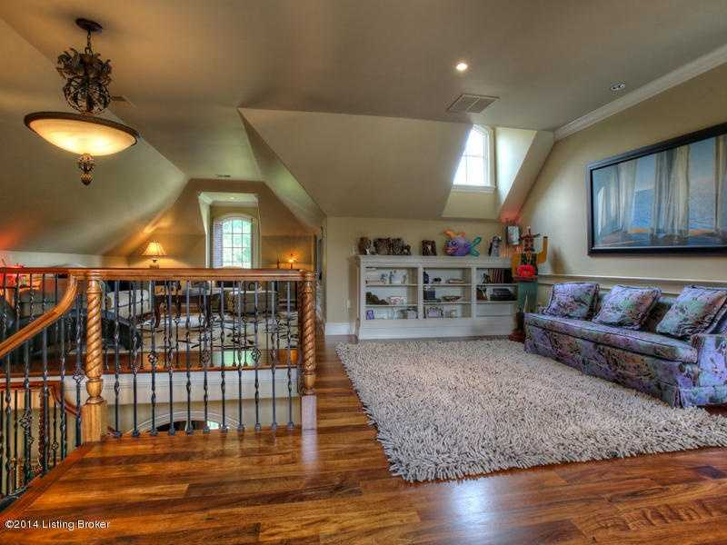 Spacious loft space can serve as a playroom for kids and hide-a-way for adults.