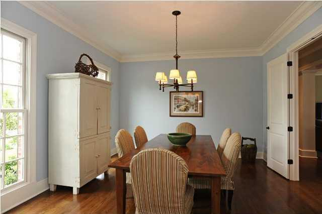 Step through beautiful double doors into the formal dining room