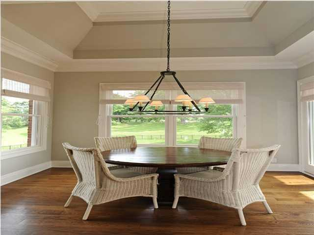 The kitchen and dining nook share not only a generous open layout, but also tranquil panoramic views.