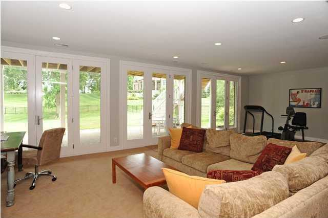 The walkout lower level has a large family room and play area, two bedrooms and a full bath.
