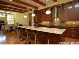 The gourmet kitchen features beautiful modern finishes and a bar seating for five.