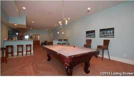Partially finished basement with a family room, bath and enormous work out area.