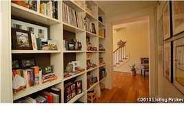 A rich bookcase along the hallway.