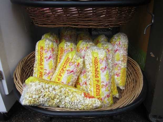 Popcorn -- I cannot resist popcorn whenever and wherever it is on sale. I eat the whole bag and then lose my voice I'm so parched.