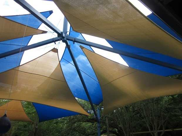 Sunshade -- I wish I could have one of these over my yard and over every park in town. No more slides as hot as an iron.