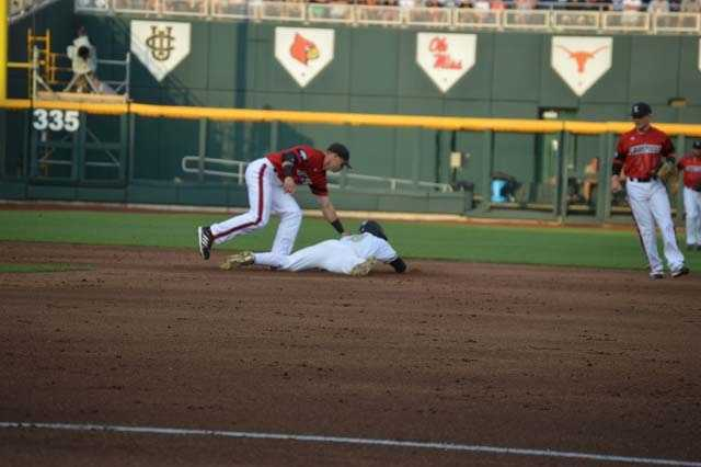 Catcher throws out a Vandy runner
