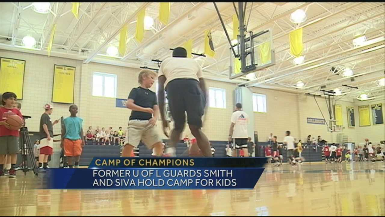 Peyton Siva and Russ Smith held a basketball camp for kids.
