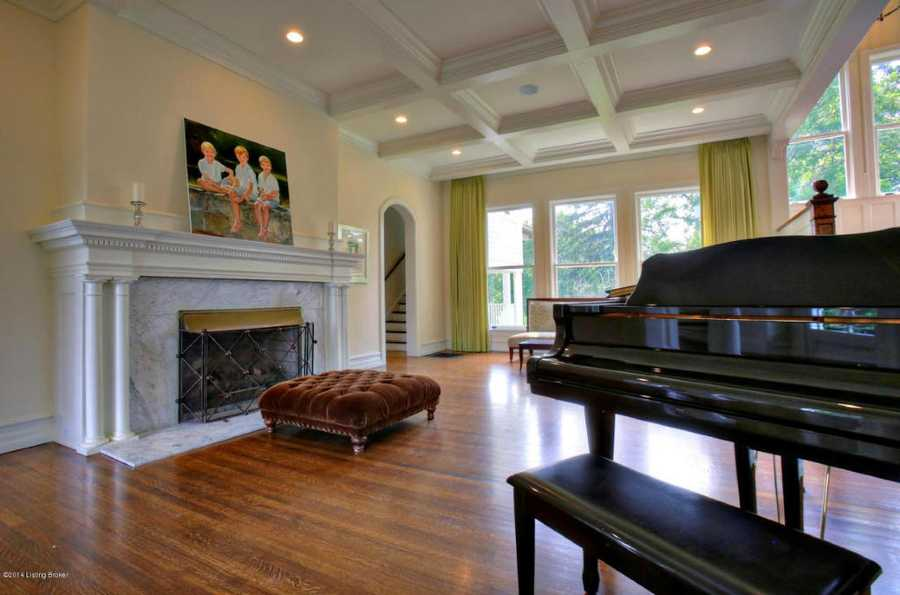 In addition this room is also complimented by a fireplace and marble mantle.