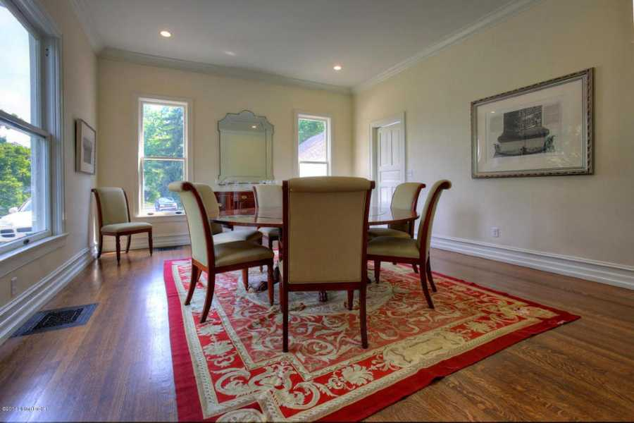 Formal dining room is spacious and features a great view.