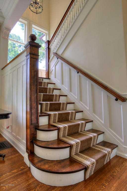 Hardwood-floored staircase.