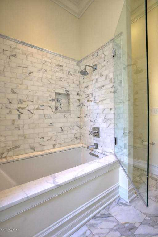 Clean lines in the marble in-cased shower.