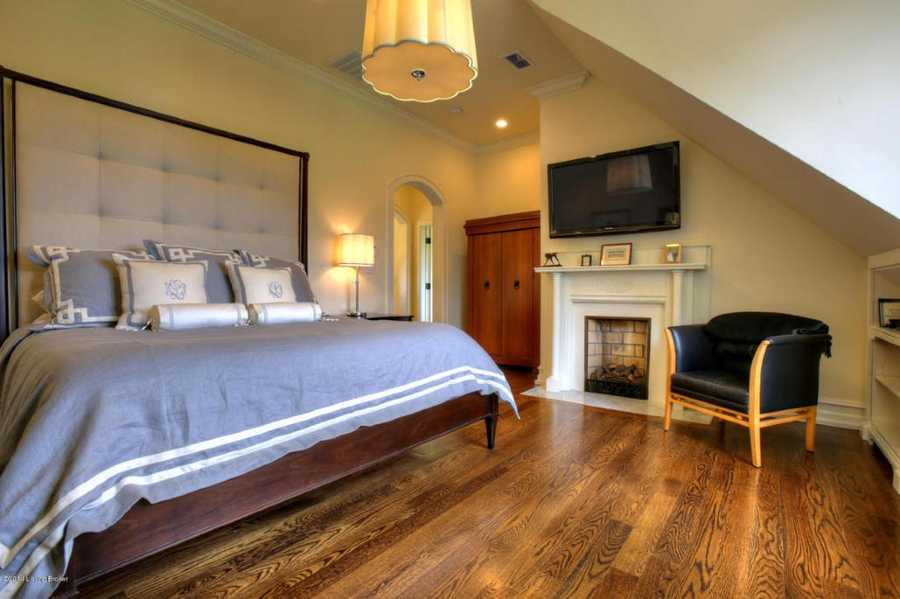 The second master suite is elegant with hardwood floors.