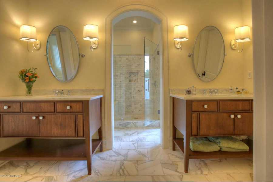This bathroom features timeless dual vanities.