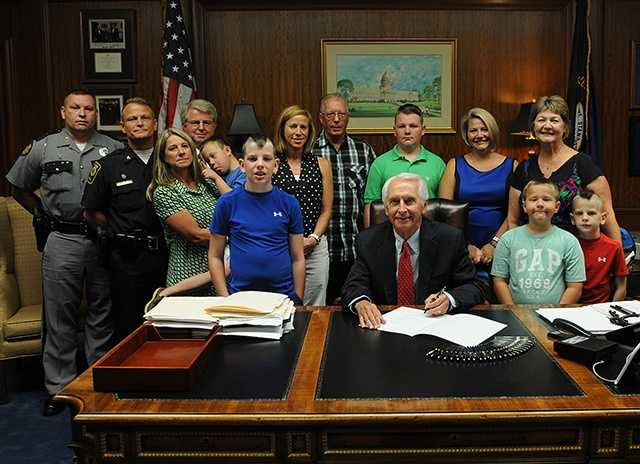 June 25, 2014: Gov. Steve Beshear signs a bill during a private ceremony with Ellis' family renaming a stretch of the Bluegrass Parkway in Bardstown in honor of Ellis.