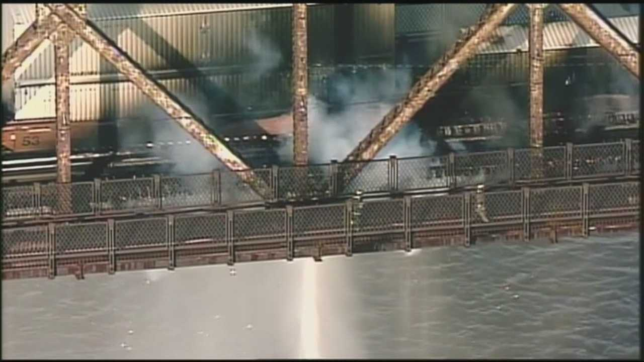 One lane of the K&I Railroad Bridge reopens after a cargo train fire on the bridge connecting Louisville to New Albany.