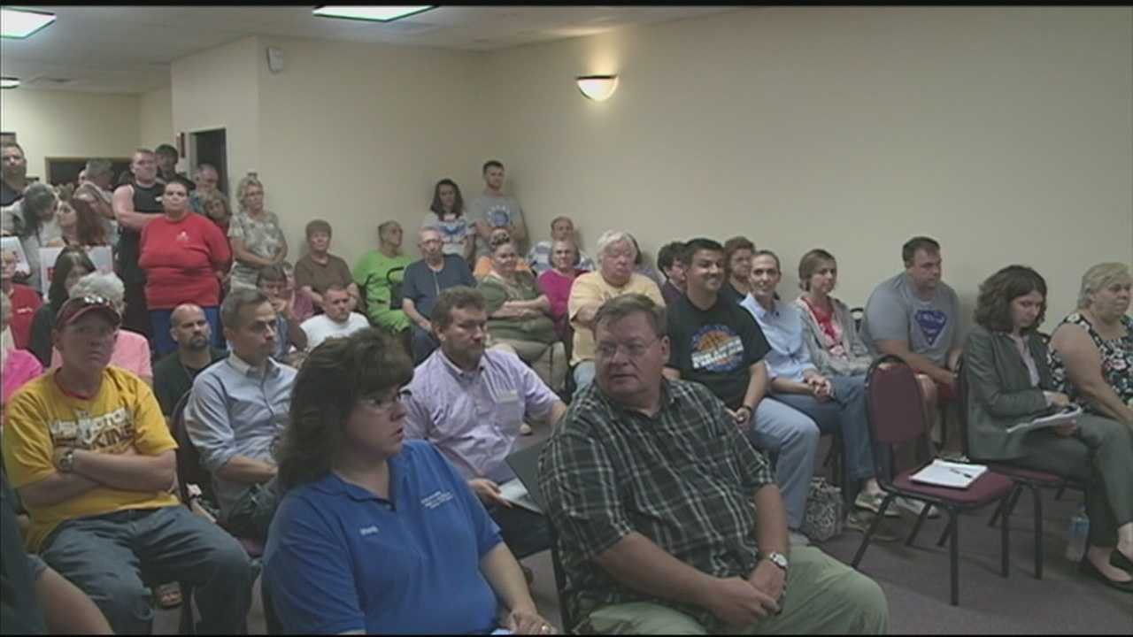 Residents in Charlestown, Indiana sound off against a plan that would kick them out of their homes.