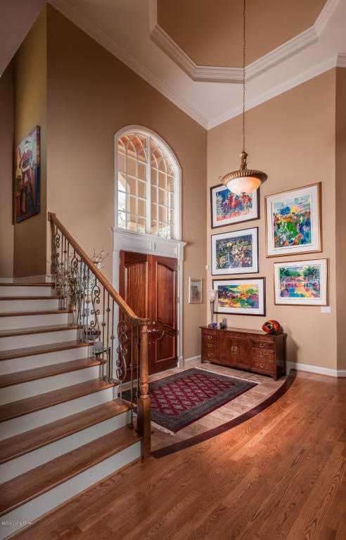 The sun-filled foyer boasts molded, vaulted ceilings.