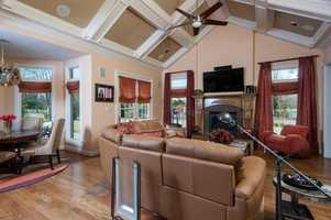The open kitchen flows into the dining nook and family room areas.
