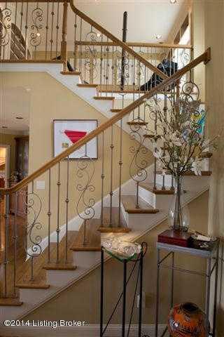 Hardwood floors along the staircase.