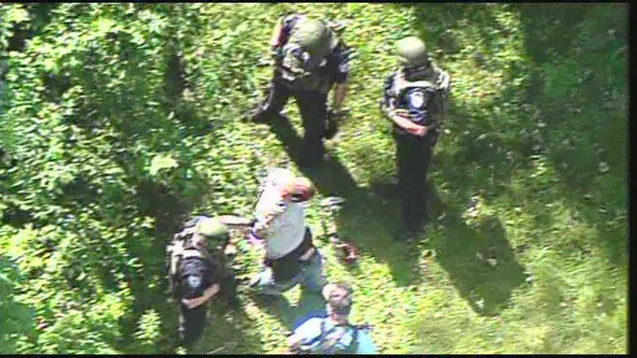 clark suspect being taken into custody.jpg
