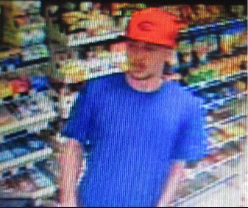 Subject 1:Mid-20sApproximately 5 feet 10 inchesShort brown hairBrown mustache and goateeUnknown tattoo on right armClothing description: Red Cincinnati Reds baseball hat, blue t-shirt, blue jean shorts and red/white shoes