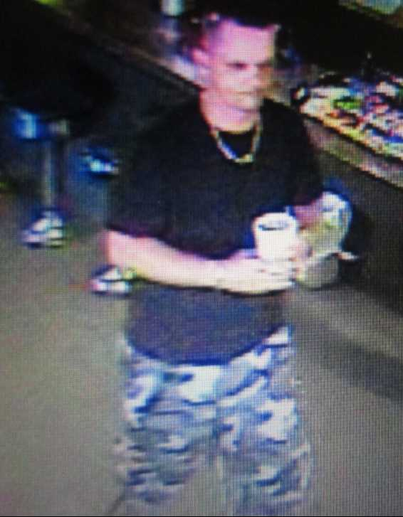 Subject 2:Approximately 30 years oldApproximately 6 feet tallShort black/dark brown hairBrown goatee and mustacheClothing description: Black t-shirt, black and gray camouflage shorts, silver necklace and black gym shoes.