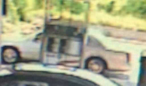 Surveillance cameras from a truck stop in Gallatin County showed the two subjects in a white or silver Cadillac Deville.