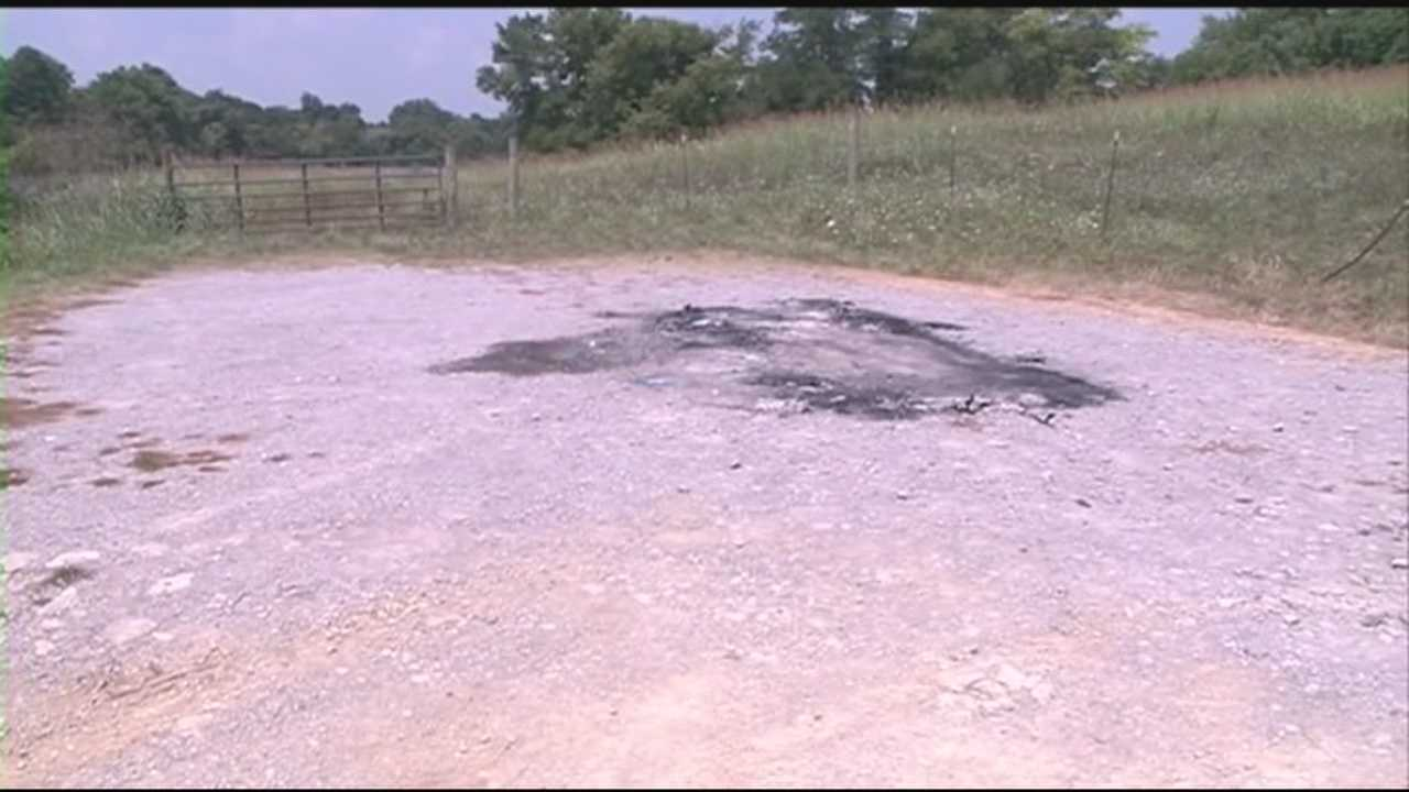 Investigation continues after body found in torched car