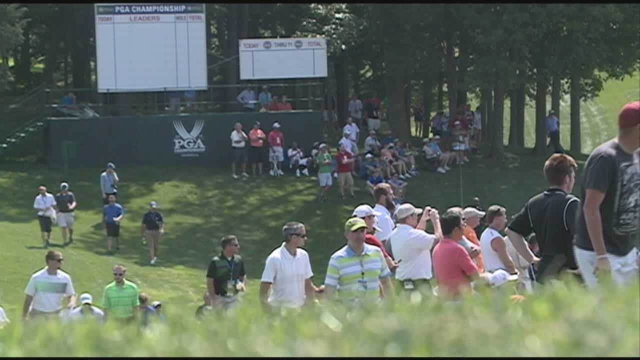 Many golf fans travel long distances to volunteer at the PGA Championship at Valhalla.
