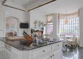 The kitchen also includes a charming breakfast nook overlooking the backyard.