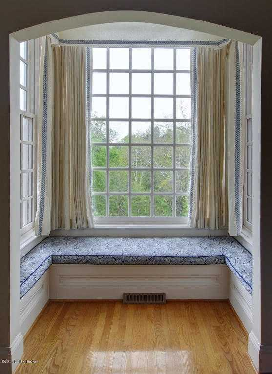 Comfortable seating along the bay window.