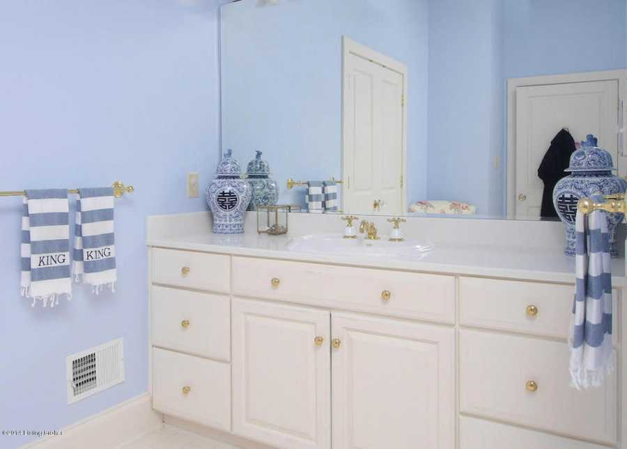 Master bathroom includes dual vanities and optimal counter space.