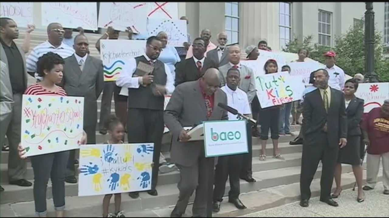 Supporters of charter schools hold rally.
