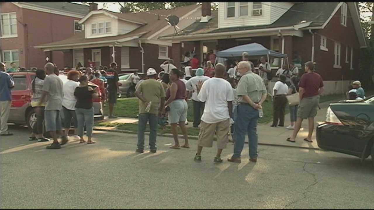 Community members gather Thursday night to speak out against the violence that claimed the life of a baby girl.