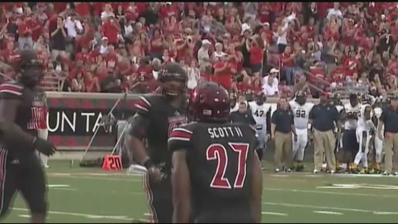 University of Louisville running back L.J. Scott is off to surprising start to his college football career.