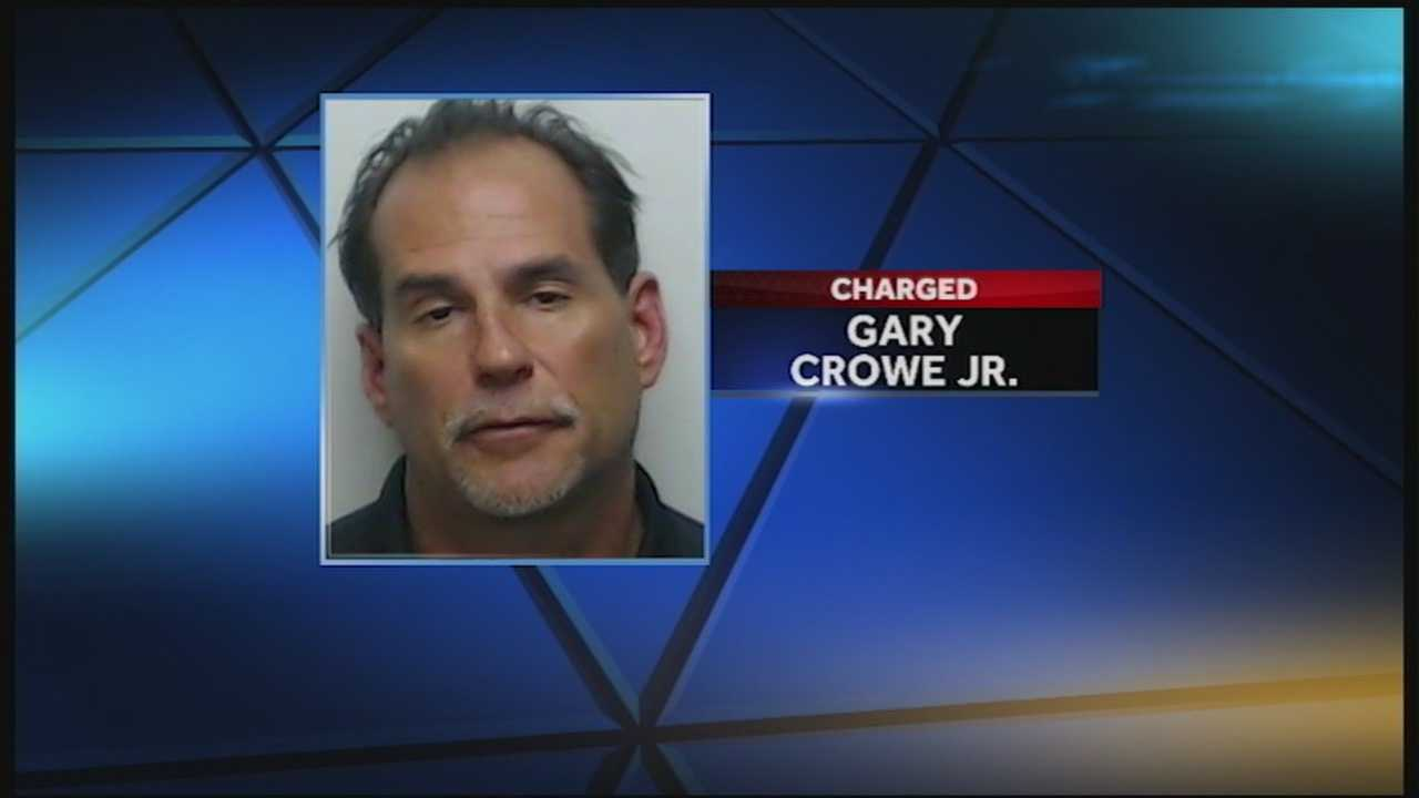 Clarksville firefighter Gary Crowe Jr. is accused of trying to kill a dog.