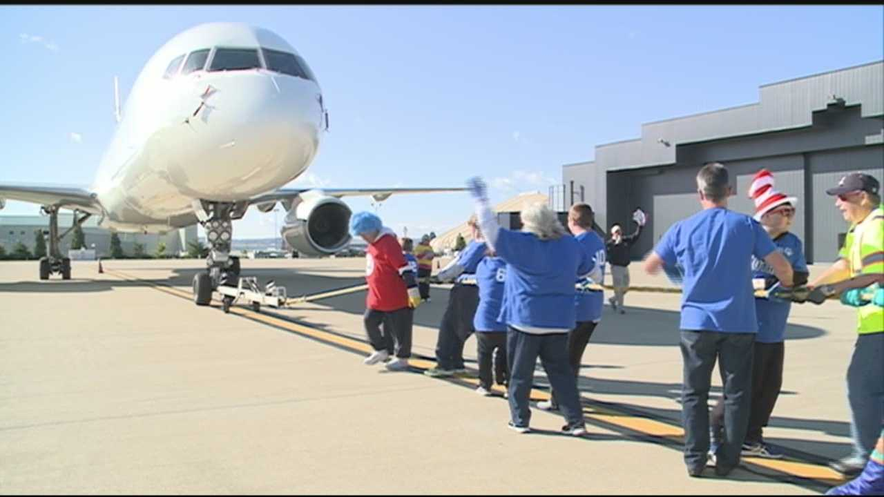 Teams from some of the area's top companies pulled more than their weight on the tarmac at Louisville's Atlantic Aviation.