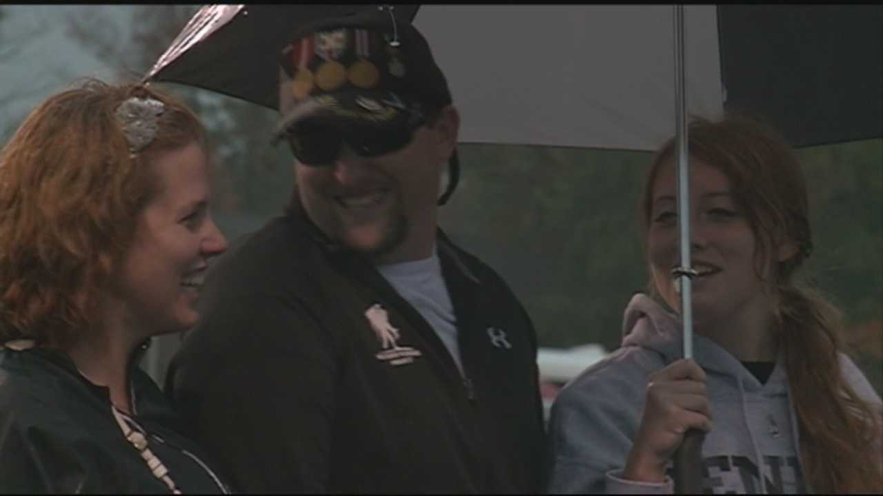 Sergeant Josh Leary surprised his daughter Brianna Leary and his wife at Friday night's Charlestown football game.