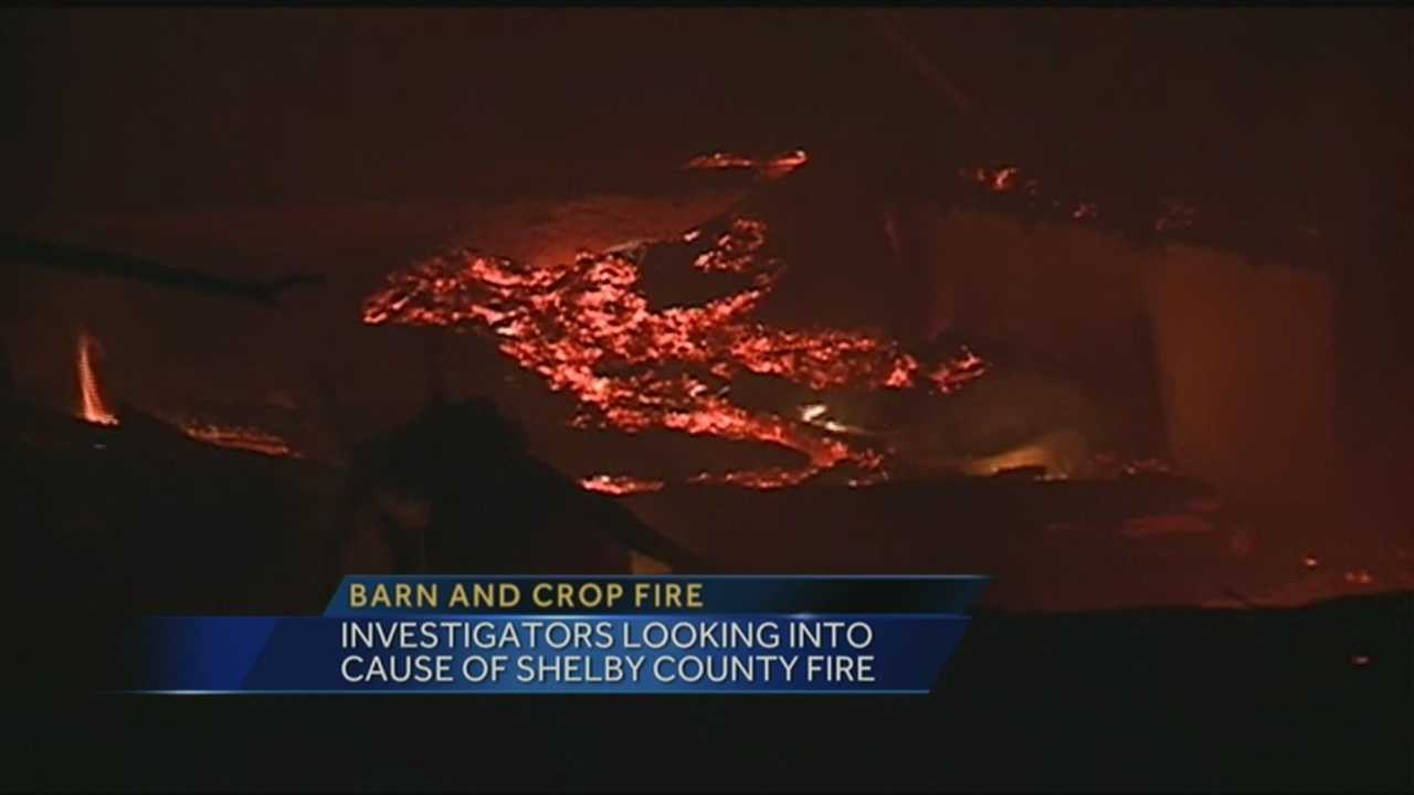 Investigators are looking into what caused a barn and crop fire in Shelby County.
