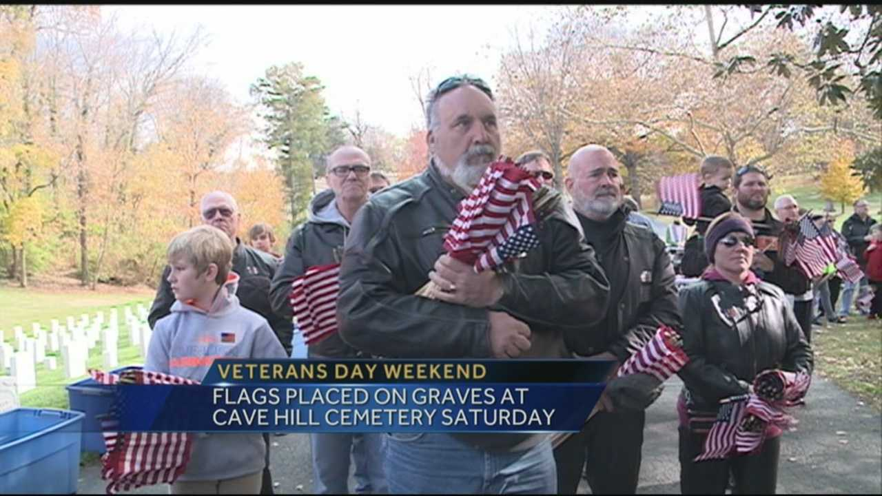 Flags were placed on graves at Cave Hill Cemetery