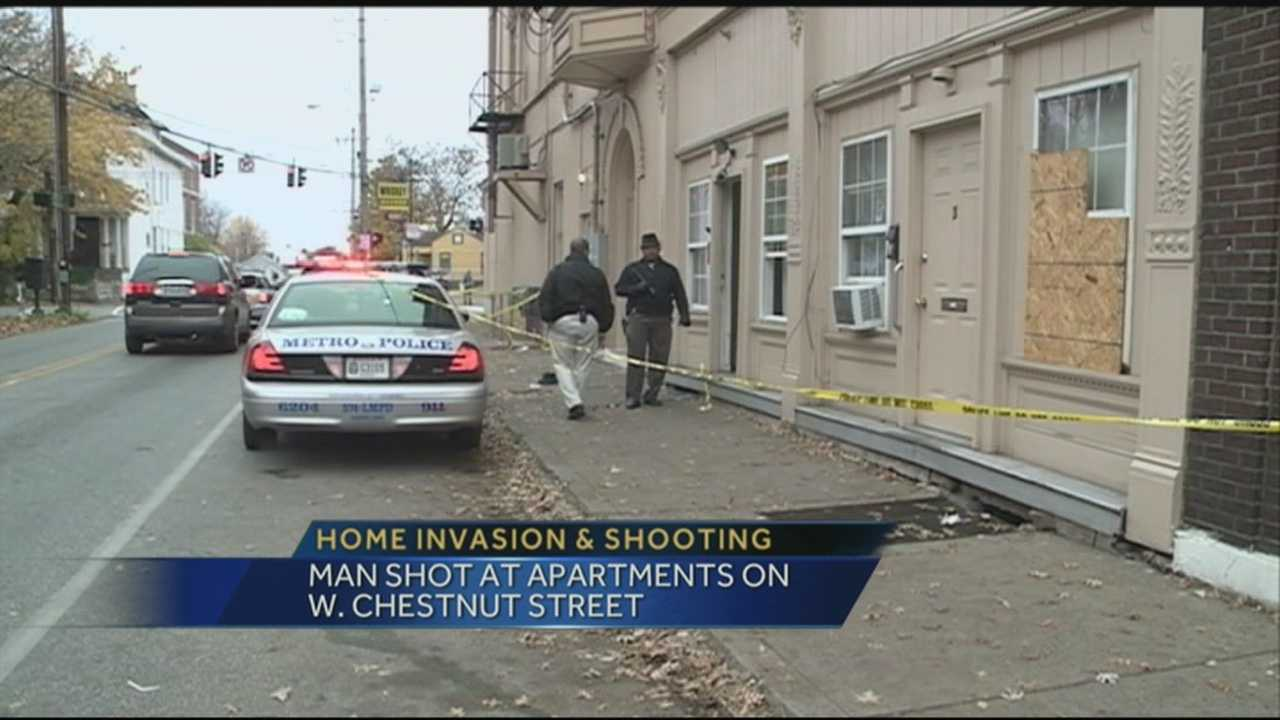 Police are searching for suspects after a man was shot at apartments on West Chestnut Street.