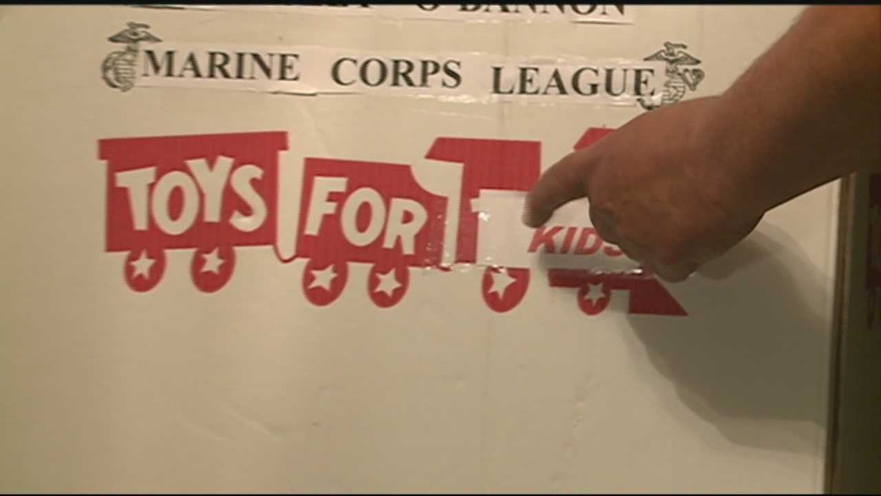 A marine and his son have been charged with stealing from Toys for Tots