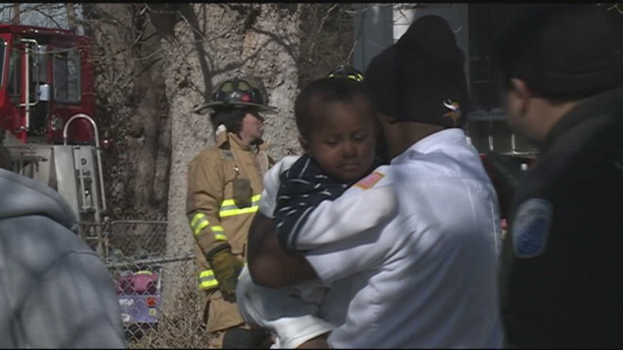 A Louisville woman and her young grandson were rescued from a burning home in the Chickasaw neighborhood Wednesday afternoon.